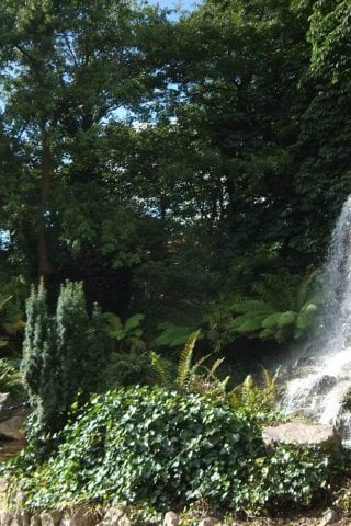 Girl at waterfall in Iveagh Gardens
