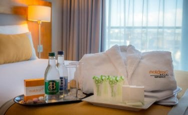 Executive Room with bathrobes water and toiletries at Maldron Hotel Smithfield