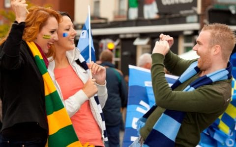 Man takes Picture of Women at Sporting Event in Dublin City