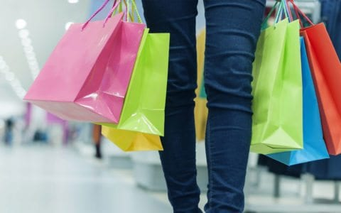 Women carries colorful Shopping Bags