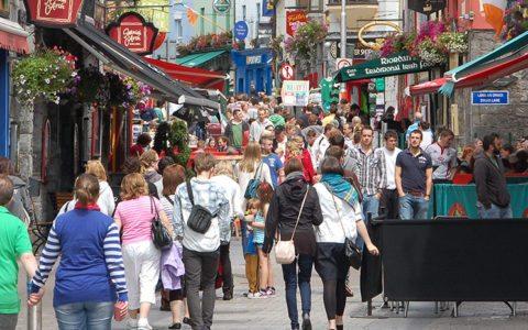 People enjoying a stroll in Quay Street Galway