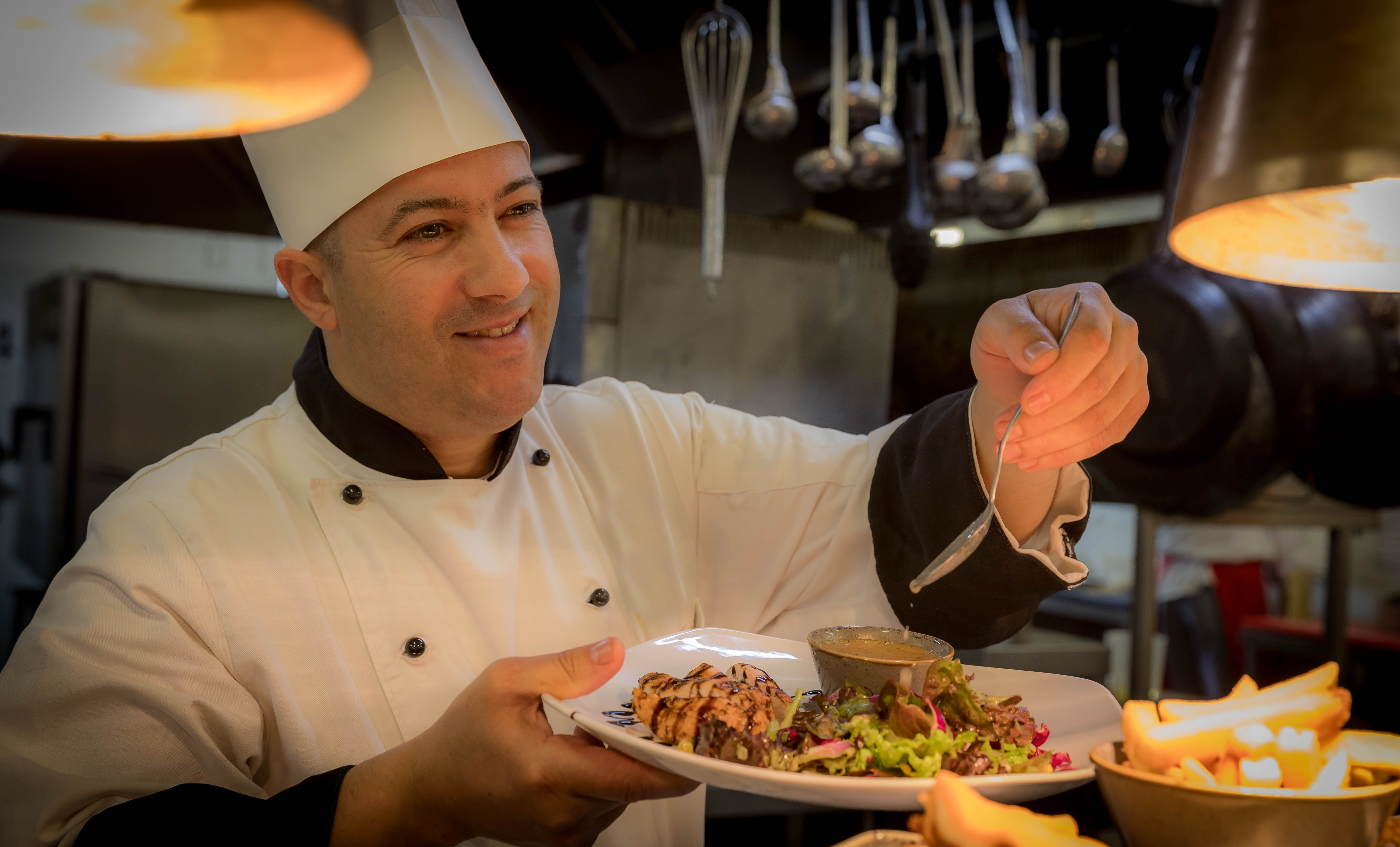 Chef preparing food in Maldron Hotel Limerick restaurant