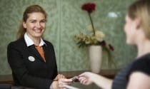 Maldron Hotel Smithfield receptionist welcoming guest to Dublin