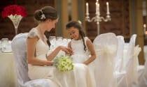 flower-girl-admiring-brides-wedding-ring-at-Shearwater-Hotel