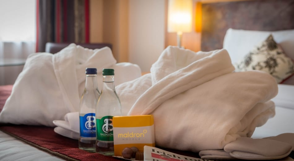 Fluffy bathrobes and mineral water in Maldron Hotel Parnell Square Dublin Executive Room