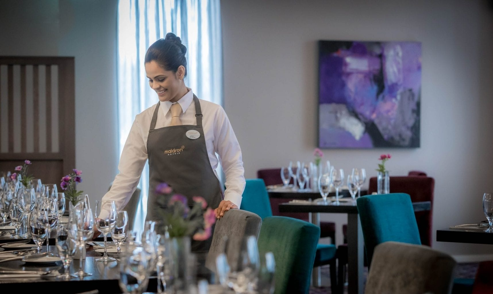 Setting table in the Apron Restaurant at Maldron Hotel Dublin Airport