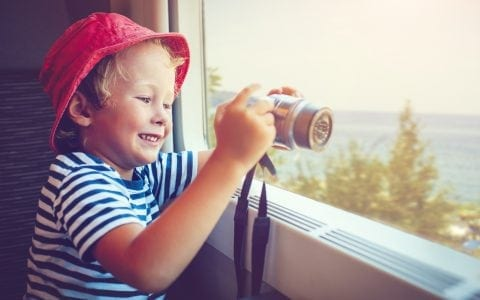 Maldron Hotels child in train with camera